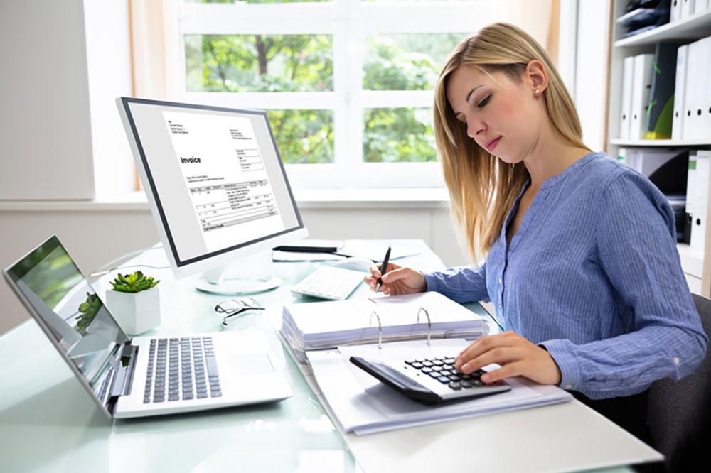 Business_people_businesswoman-calculating-invoice-medium-res